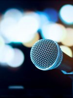 Microphone on abstract blurred of speech in seminar room or speaking conference hall light, Event concert bokeh background